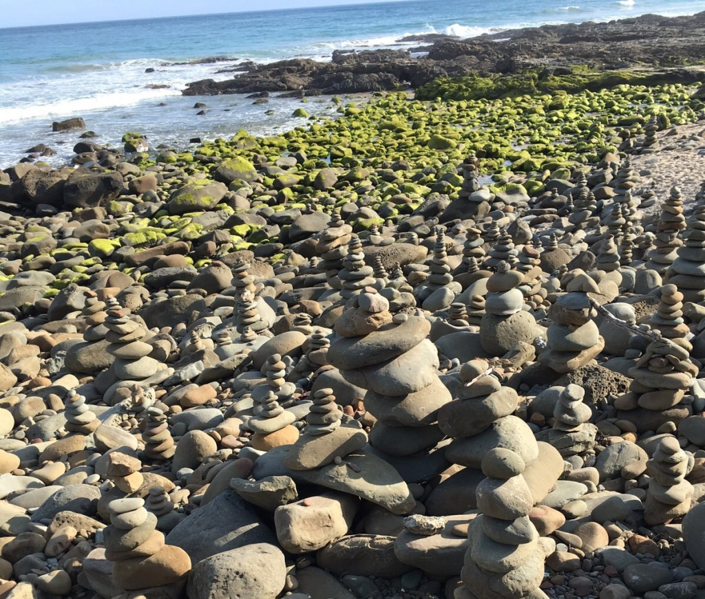 The pebble towers were waiting to be embraced by the white waves