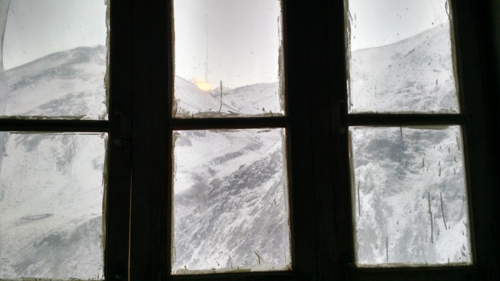The view of the snowcapped mountains from the window of the homestay